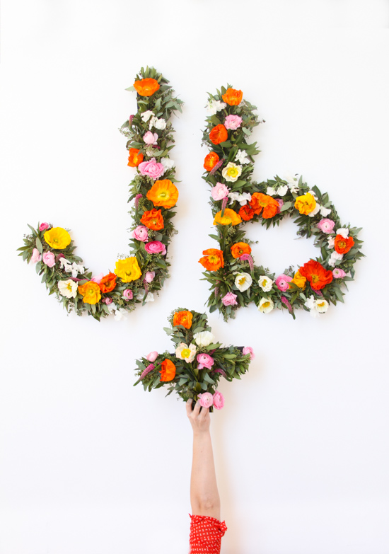 flower-typography-wall-art-with-hand-white-wall-2