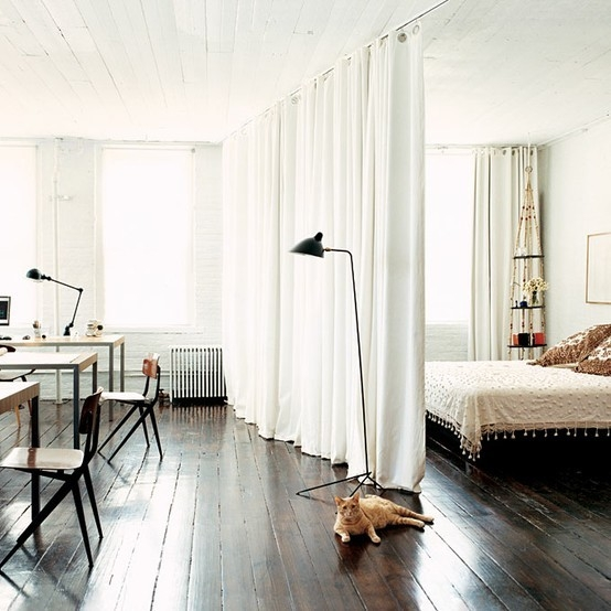 Hardwood Floors and White Curtains in Studio Space