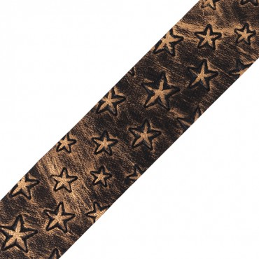 "Our celestial 1 1/2"" Star Embossed Vinyl Ribbon will leave you starstruck! This gorgeous ribbon is embossed with stars in various sizes, giving it a fun and carefree vibe. The texture of the shapes on the leather-like trim adds to its unique style. Use it"